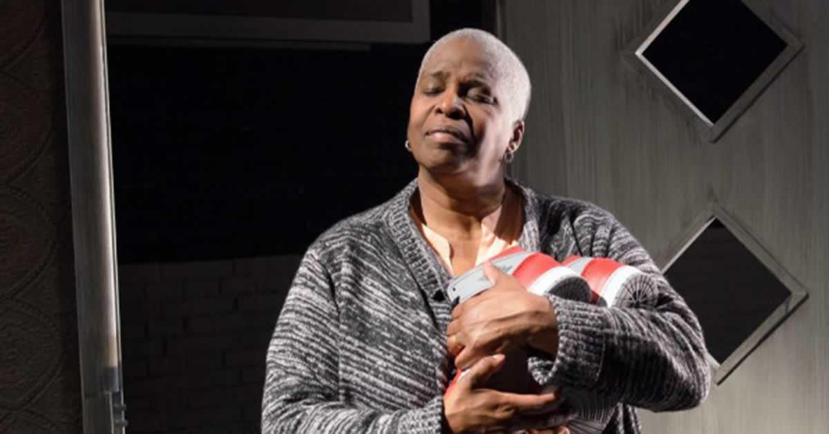 Cheryl Lynn Bruce holding a pair of shoes