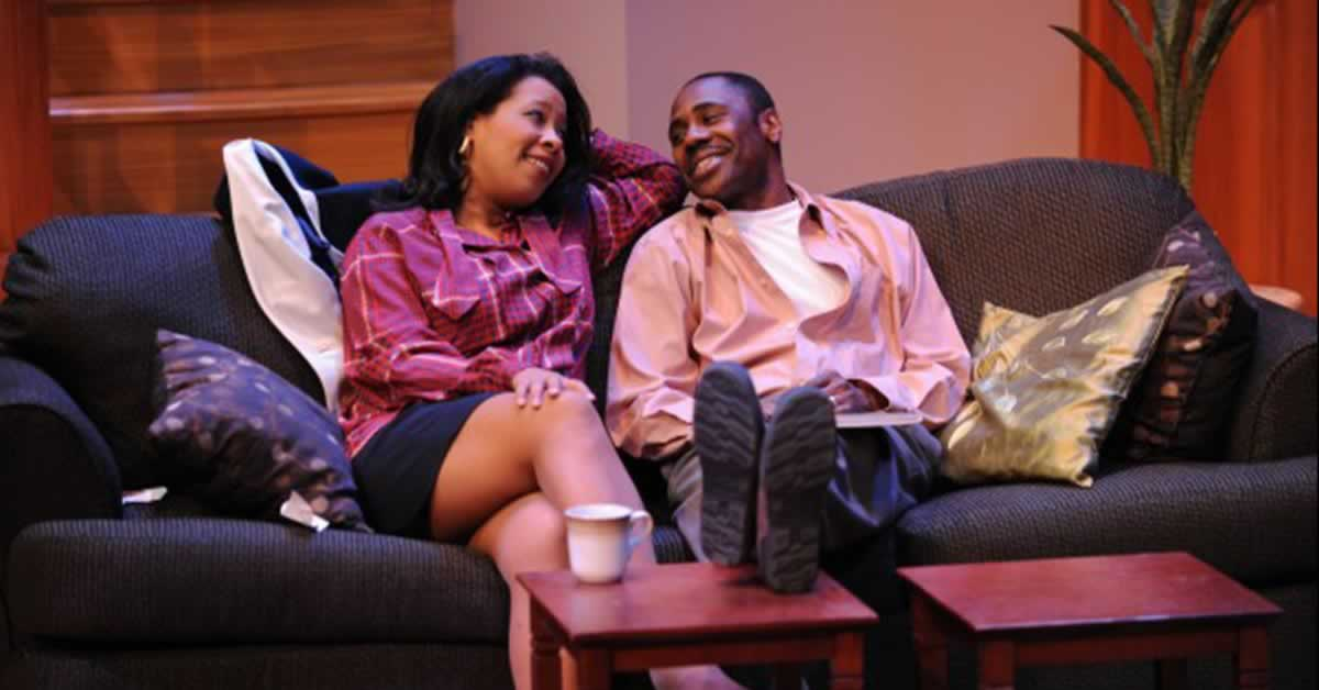 Melanie E. Brezill and Corey Marshaun Cantrell sitting on a couch