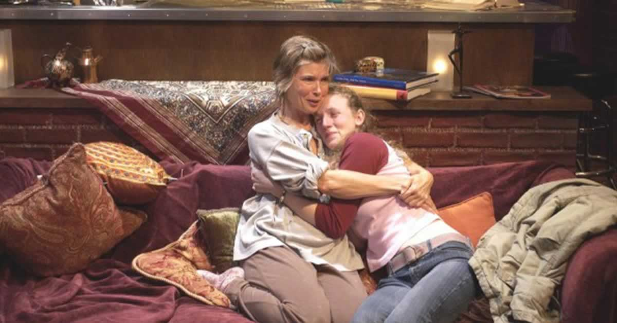 Taylor Miller embracing Casandra Bissell on a couch