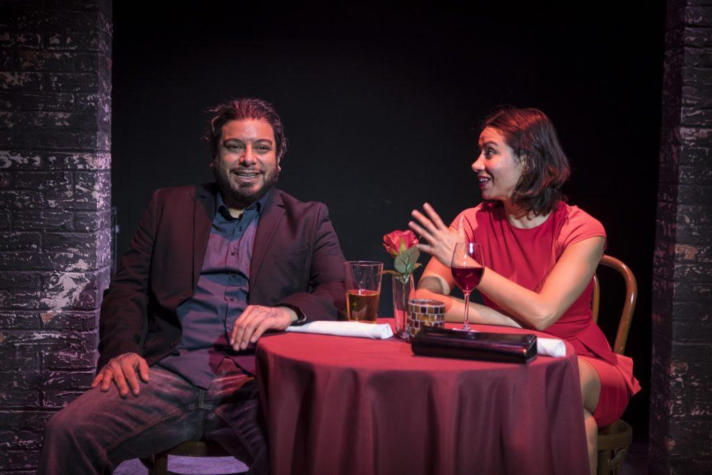 Eddie Martinez and Monica Orozco sitting at a restaurant