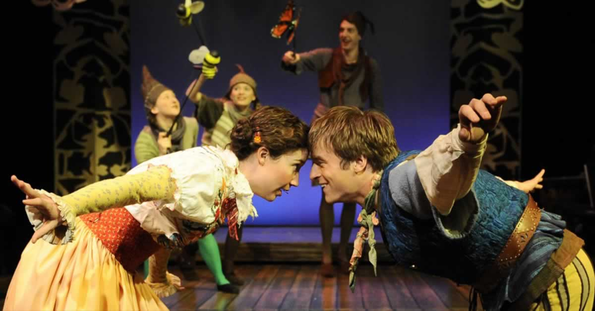 Blair Robertson and Patrick Andrews stand face to face while Nicole Pellegrino, Lindsay Noel Whiting and Jackson Evans puppeteer in the background
