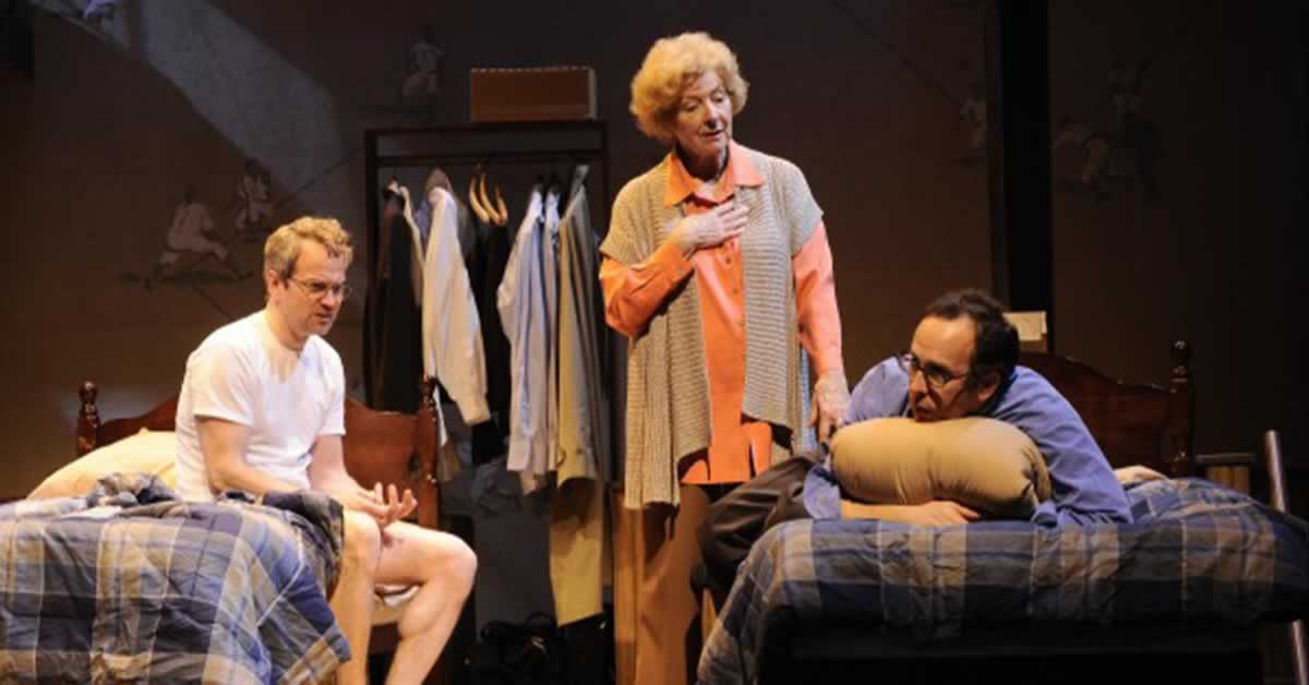 Steve Key, Mary Ann Thebus and Joe Dempsey in a bedroom