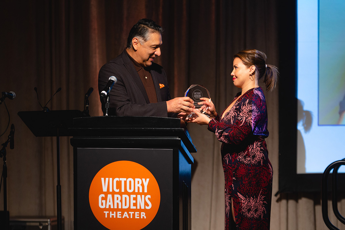Justina Machado receiving her Impact Award