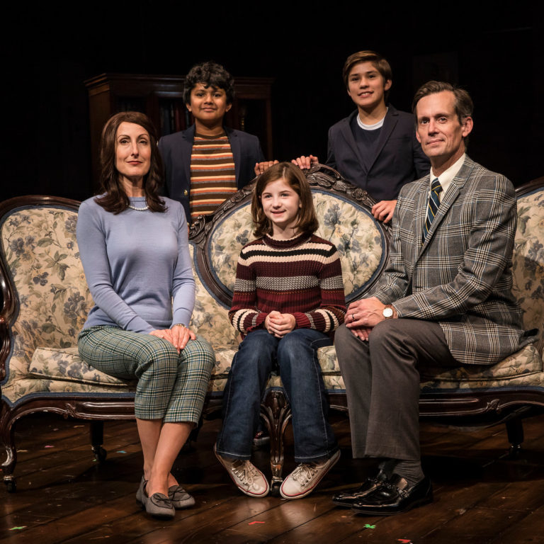 Preetish Chakraborty, Leo Gonzalez, McKinley Carter, Stella Rose Hoyt and Rob Lindley seated around a couch posing for a family photo
